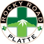 circle logo of rocky road on platte with green cross in the middle